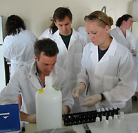 Photo of students in labcoats.